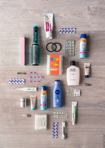 Cosmetics and toileteries ready to pack for a city break in the UK